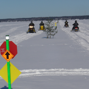 Snowmobilers on a lake in Whiteshell Provincial Park, Manitoba