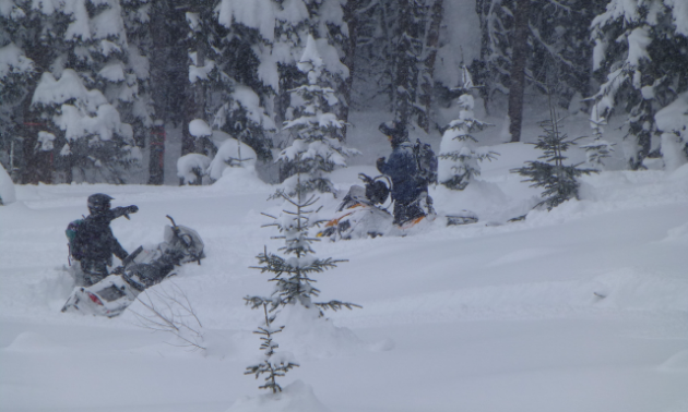 Some snowmobilers got stuck during the poker run last year. Mike and Harvey Jones usually run the sweepers at the back of the pack and pull everyone out.