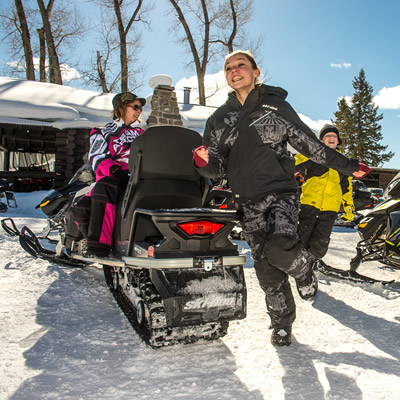 Family getting ready to go snowmobiling.