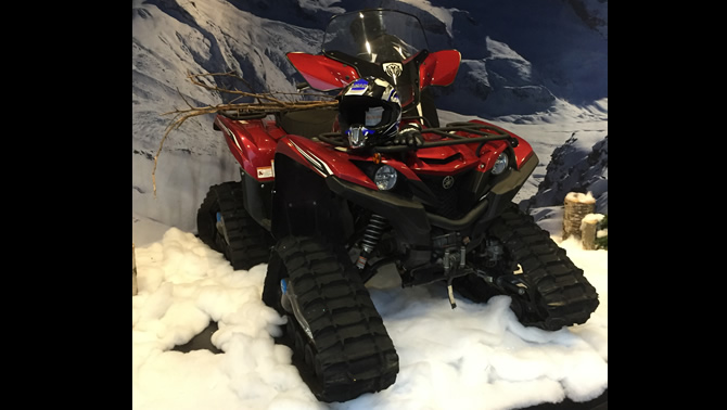 A Grizzly ATV with a Camoplast 4TS track conversion kit.