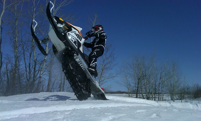 man doing a wheelie with his sled