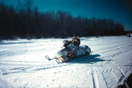 sledder on the trail