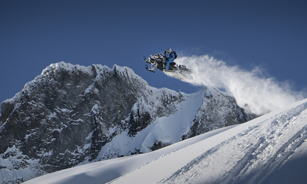 Andrew Munster doing a huge jump in the Whistler mountains.