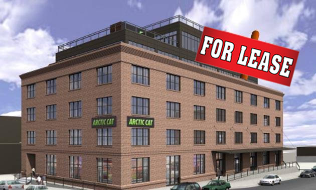 Former Arctic Cat building with For Lease sign on it.