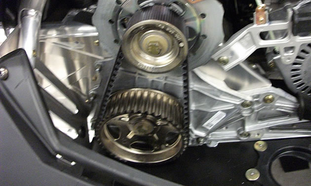 Belt drive system on a sled engine.