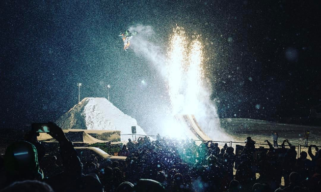 people gathering at an event for snowmobilers