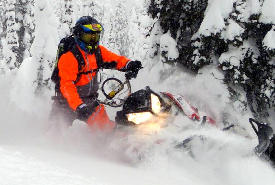 Orange Blitzkrieg monosuit for snowmobiling.
