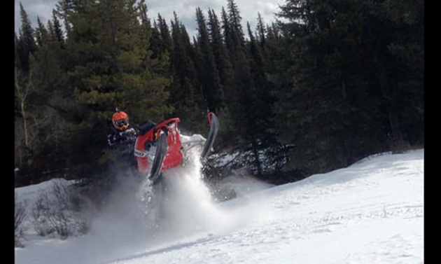 Blair Trueman is airing out his sled in Blue River forested terrain.