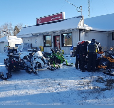An early morning fuel up for the ride ahead for a group of sledders heading out with Bob Brandt.