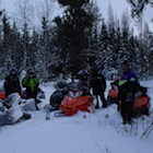Men and snowmobiles