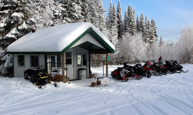 Sleds parked outside the Bradshaw Mill Shelter in the Pasquia Hills.