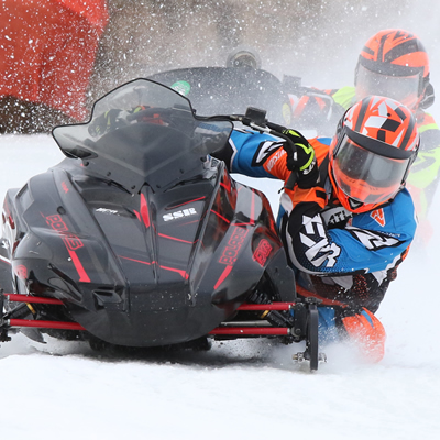 Brennan Boxall surges toward the camera in an ice oval race.