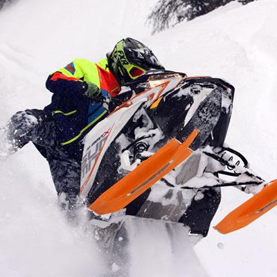 Bret Rasmussen riding toward the camera with amazing mountain backdrop.