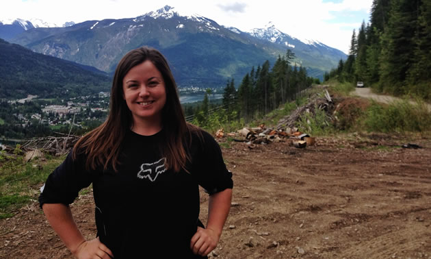 Brianna Lukkar poses for a head and shoulders photo with Revelstoke in the background.