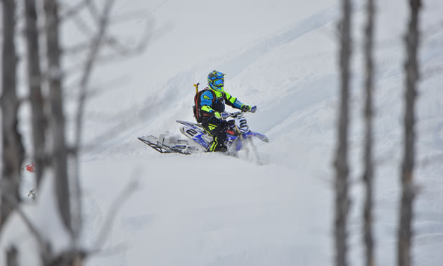 Brock Hoyer sitting on his snow bike in the backcountry.