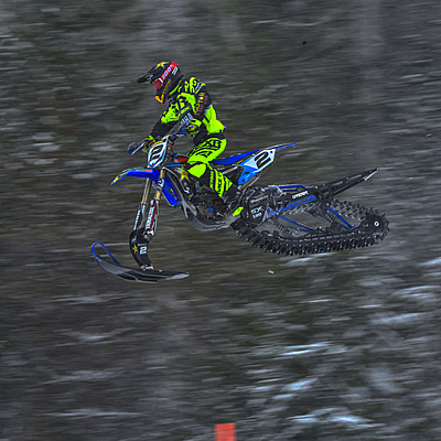 Brock Hoyer soars through the air during the Revelstoke snow bike races.