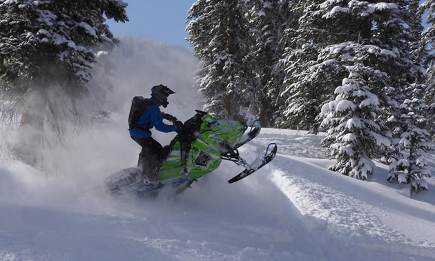 Snowmobiler in deep powder.
