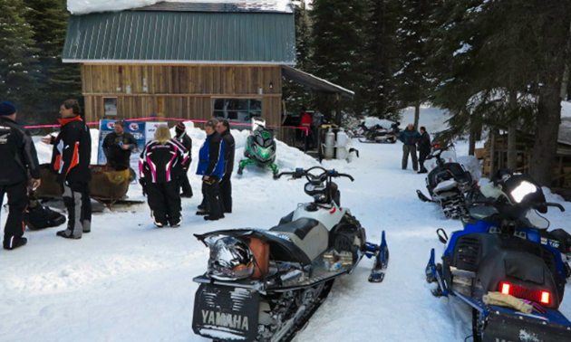 Club members at the snowmobile club's cabin.