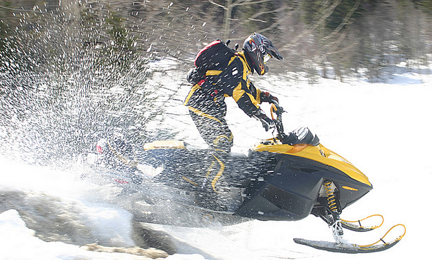 man snowmobiling