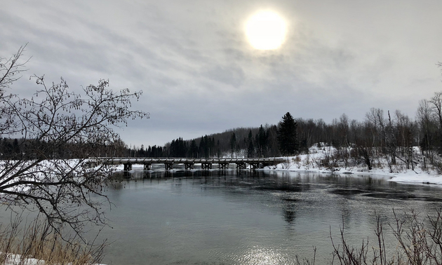 cloudy skies and a bridge over Cold Lake