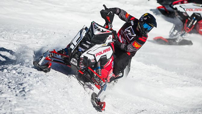 Corin Todd on snowmobile.