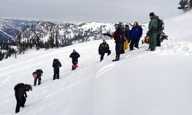 A group of AST students on a small cornice.