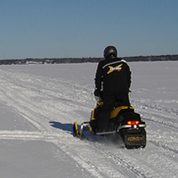 Snowmobiling in Whiteshell Provincial Park, Manitoba.