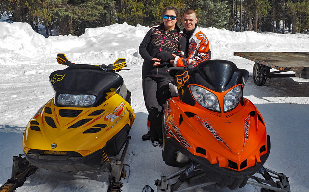 Snowmobiling couple.