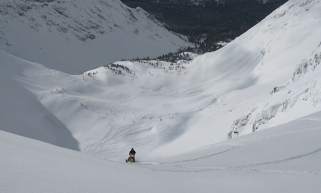 A sledder in the middle of an enormous bowl in the Crowsnest Pass.