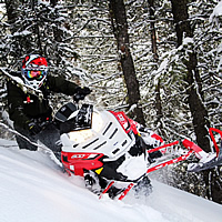 Dan Adams on red and white Polaris Assault RMK.