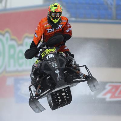 David Joanis snocross racer flies through the air in a race.