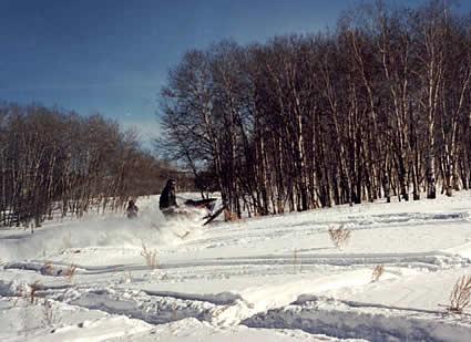 Person sledding through the terrain of Yorkton