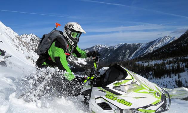 a snowmobiler blasting through fresh in Fernie.