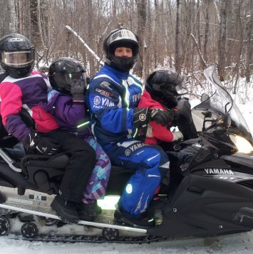 Kids getting ready for some sledding in Duck Mountain, Saskatchewan. Photo courtesy Saskatchewan Snowmobile Association Inc