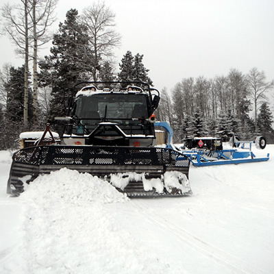 A snowmobile trail groomer in Edson.