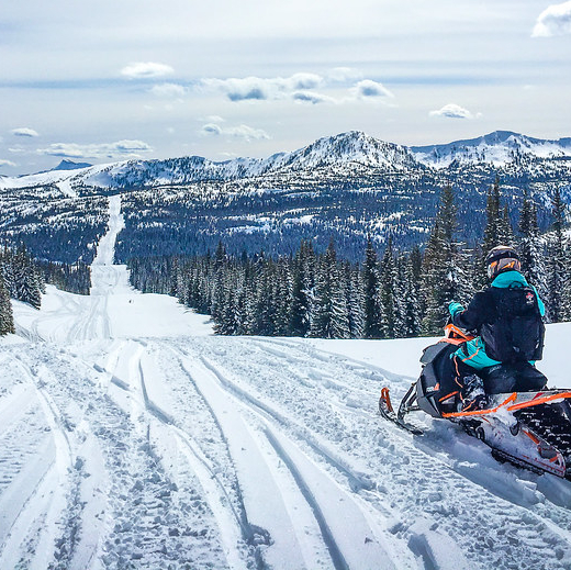 snow in the elk valley and a snowmobiler on the trail