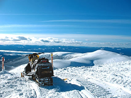 snowmobile at the top of a mountain viewpoint