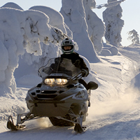 Snowmobiling on trails in Finland.