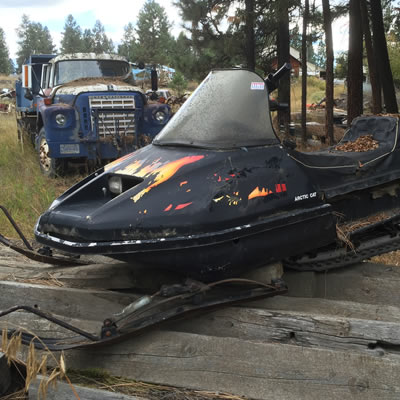 A picture of a vintage Arctic Cat snowmobile with flaming decals.
