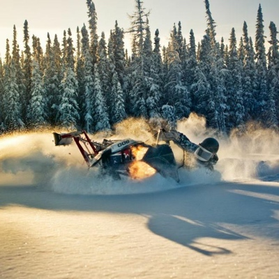 A snowmobiler enjoying the powder of Fort McMurray