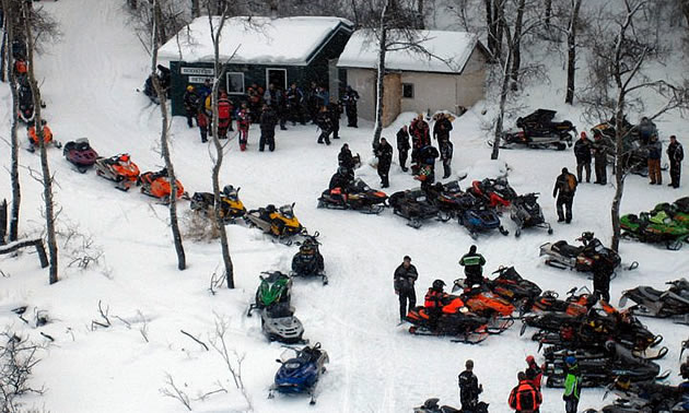 An aerial shot of snowmobilers during a poker derby.