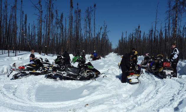 A group of riders stopping for a break on the Fort McMurray
