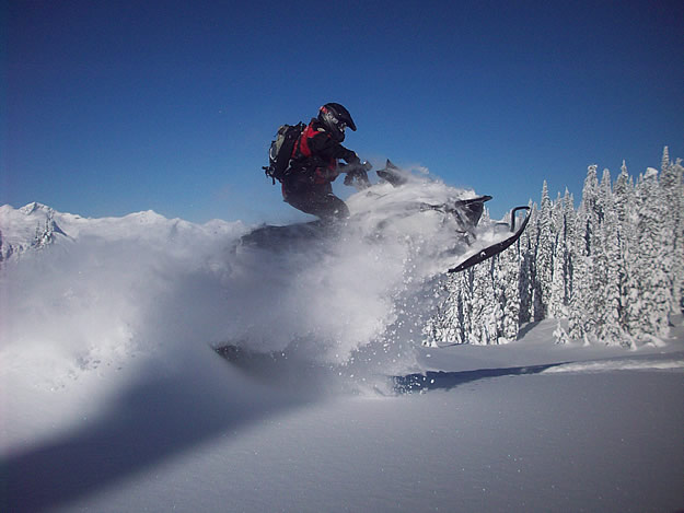 Photo of a snowmobile taking a jump