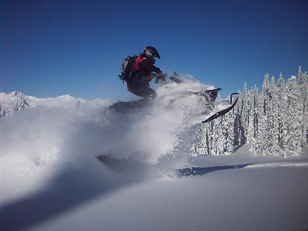 Photo of a snowmobile taking a jump
