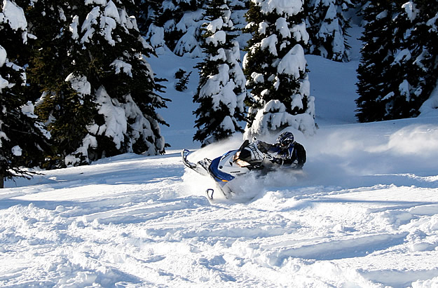 Photo of a snowmobiler tearing it up