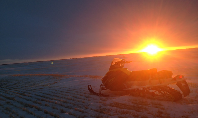 Snowmobile in the sunset in Saskatchewan.
