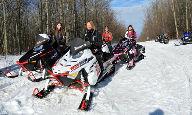 Four snowmobilers on Polaris Pro-RMK sleds in Whitecourt.