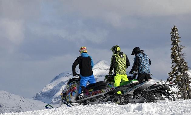Three riders looking down a steep grade.