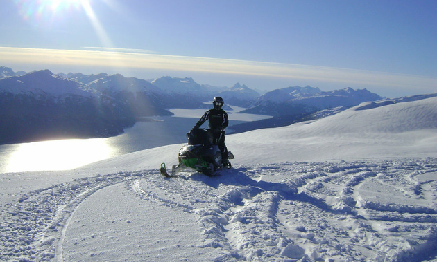 A snowmobiler is out enjoying a glorious sunny day in the Sibolas/Rhine Ridge area near Houston, B.C.