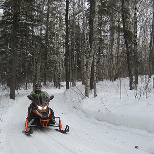 Club member Carl Palke riding the Greenbush trails. Part of the Hudson Bay trails wind through the forest.